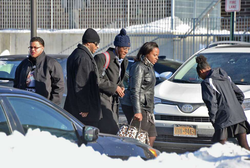 Family members arrive at Troy Middle School for a funeral service Saturday Jan. 6, 2018, for victims murdered in a basement apartment on Second Ave. last month in Troy, NY. (John Carl D'Annibale / Times Union)