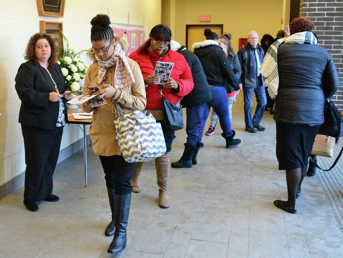 Mourners file into Troy Middle School for a funeral service Saturday Jan. 6, 2018, for victims murdered in a basement apartment on Second Ave. last month in Troy, NY. (John Carl D'Annibale / Times Union)