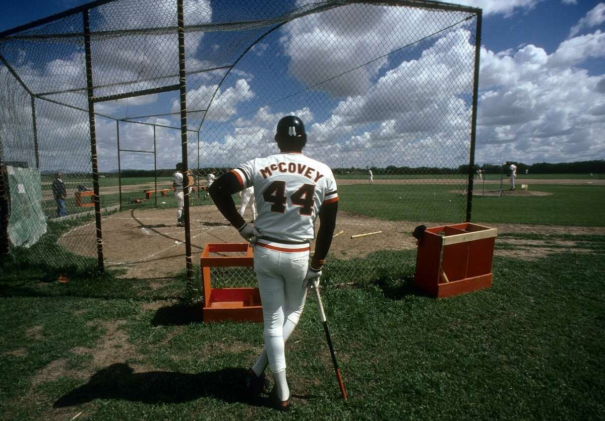During spring training in Phoenix in the mid-1970s, Giants first baseman Willie McCovey stands at the batting cage awaiting his turn to hit. McCovey spent 19 seasons with the Giants.