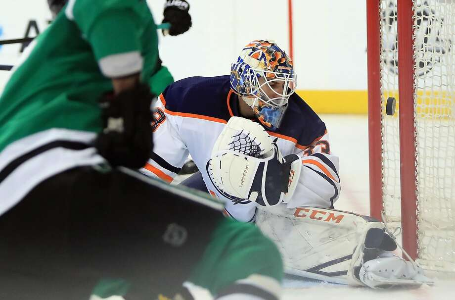 Oilers goalie Cam Talbot is beaten by Stars' Alexander Radulov in the first period in Dallas. Photo: Ronald Martinez, Getty Images