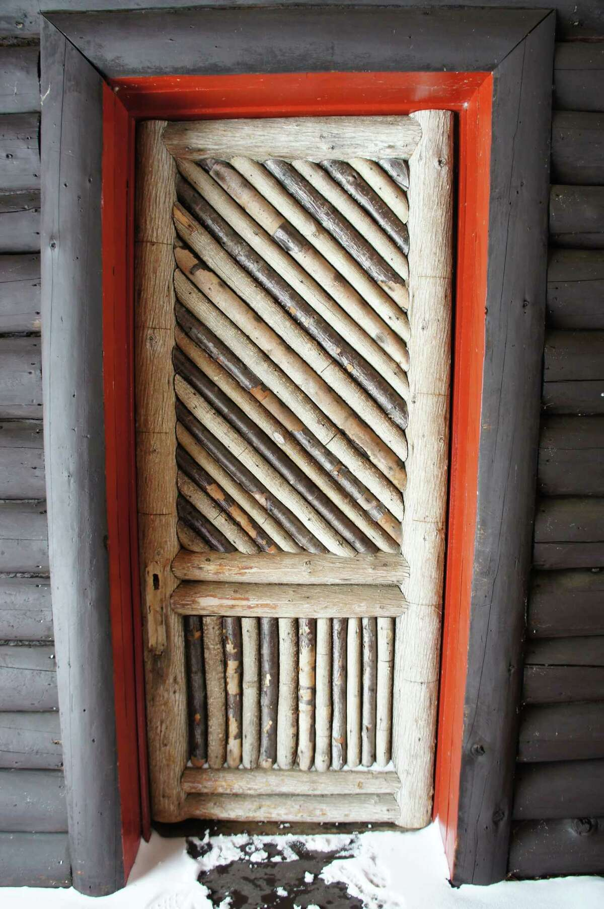 Photo by Gillian Scott. One of the exterior doors at Camp Santanoni in Newcomb.