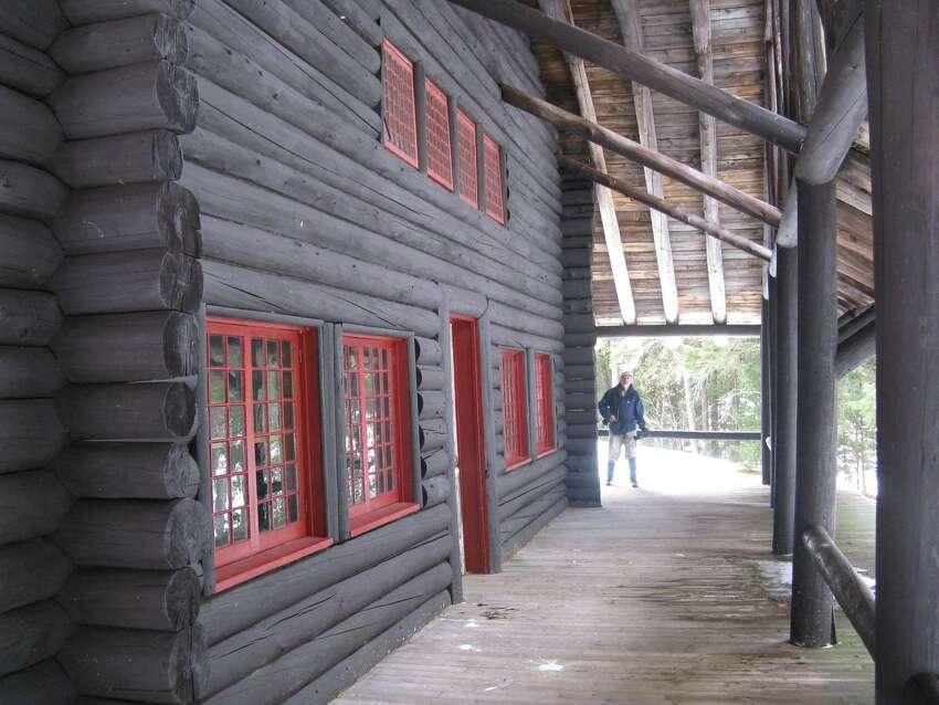 Photo by Gillian Scott. The main hall of Camp Santanoni shares a porch and roof system with five other buildings.