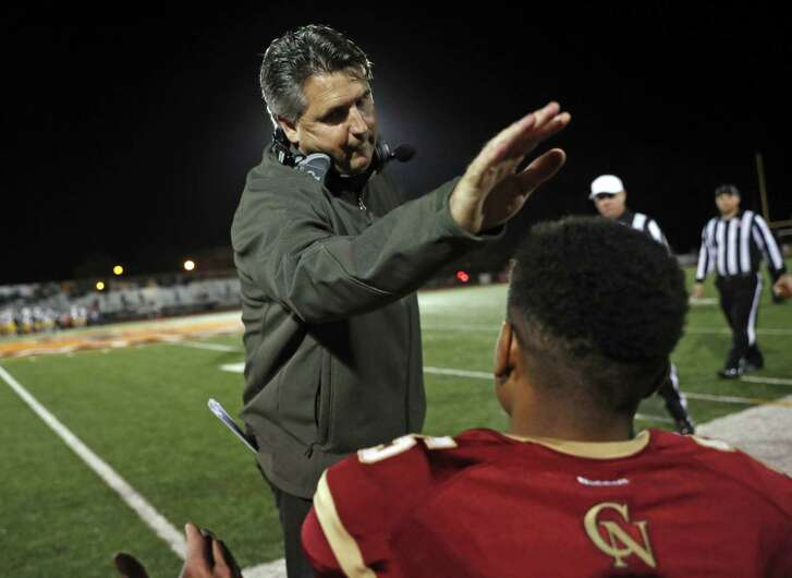 Cardinal Newman head coach Paul; Cronin pats wide receiver Nikko Kitchen on the head before playing Kennedy during NCS playoff game at Santa Rosa High School in Santa Rosa, Calif., on Friday, November 10, 2017.