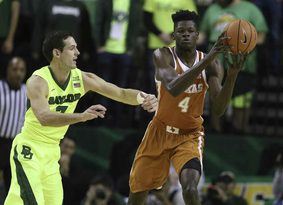 Texas forward Mohamed Bamba, right, pulls down a rebound over Baylor guard Jake Lindsey, left, in the second half of an NCAA college basketball game, Saturday, Jan. 6, 2018, in Waco, Texas. Baylor won 69-60. (Rod Aydelotte/Waco Tribune-Herald via AP) Photo: Rod Aydelotte, MBO / Associated Press / Waco Tribune-Herald
