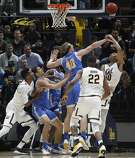 UCLA's Thomas Welsh (40) blocks a shot by California's Justice Sueing, right, during the first half of an NCAA college basketball game Saturday, Jan. 6, 2018, in Berkeley, Calif. (AP Photo/George Nikitin)