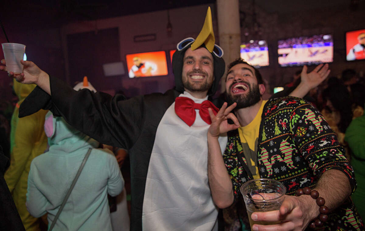 Locals warmed up Friday night Jan. 5, 2018,at downtown bars with cosy, warm onesies and alcohol. It was the First Friday Onise Pub Run.