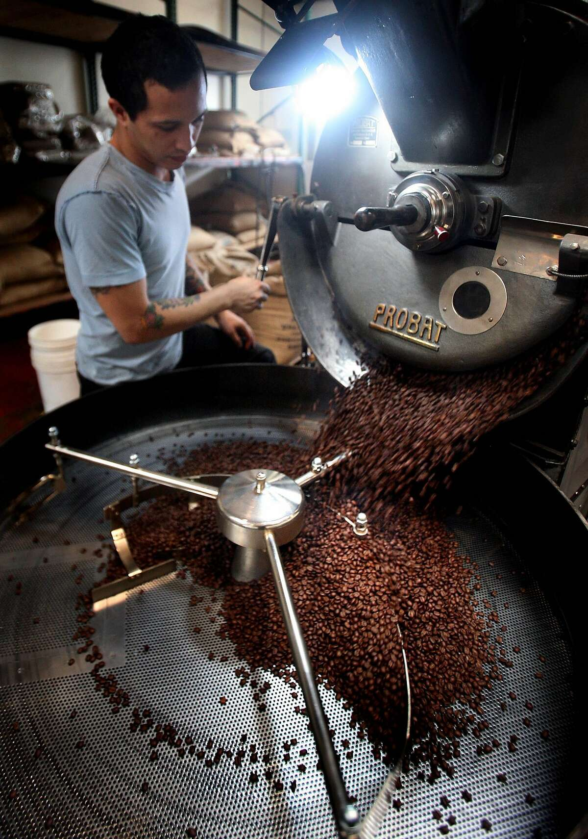 Jeremy Tooker inspects a batch of coffee he's roasting at Four Barrel Coffee in 2009.