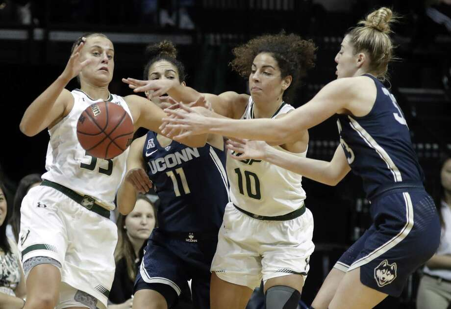 South Florida's Kitija Laksa, left, and Laura Ferreira, third from left, battle with UConn's Kia Nurse (11) and Katie Lou Samuelson for a loose ball on Saturday. Photo: Chris O'Meara / Associated Press / Copyright 2018 The Associated Press. All rights reserved.