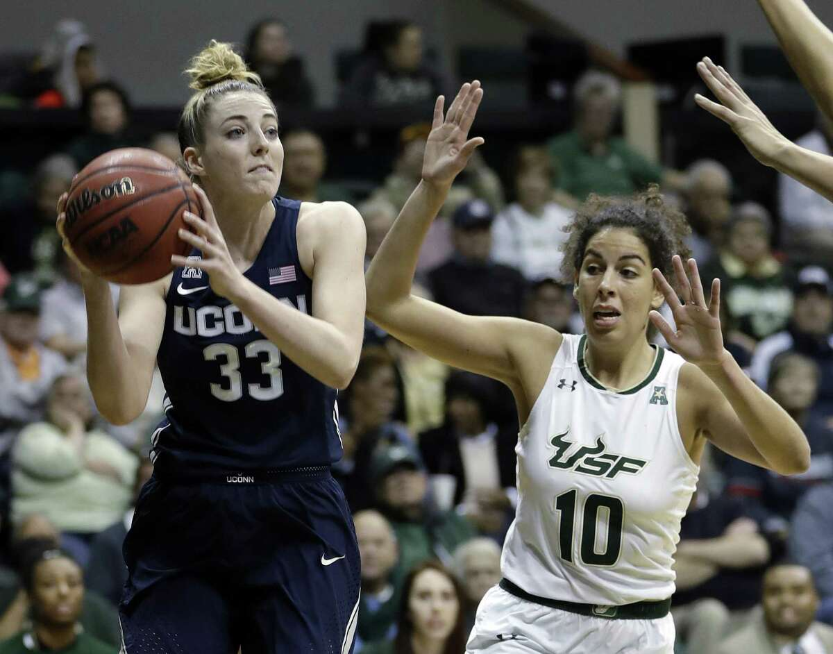 UConn's Katie Lou Samuelson (33) looks to pass during Saturday's game against USF.