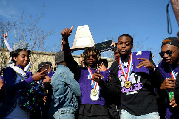 Newton football players during a community celebration for the football team's Class 3A Division II state championship on Saturday afternoon. Photo taken Saturday 1/6/18 Ryan Pelham/The Enterprise