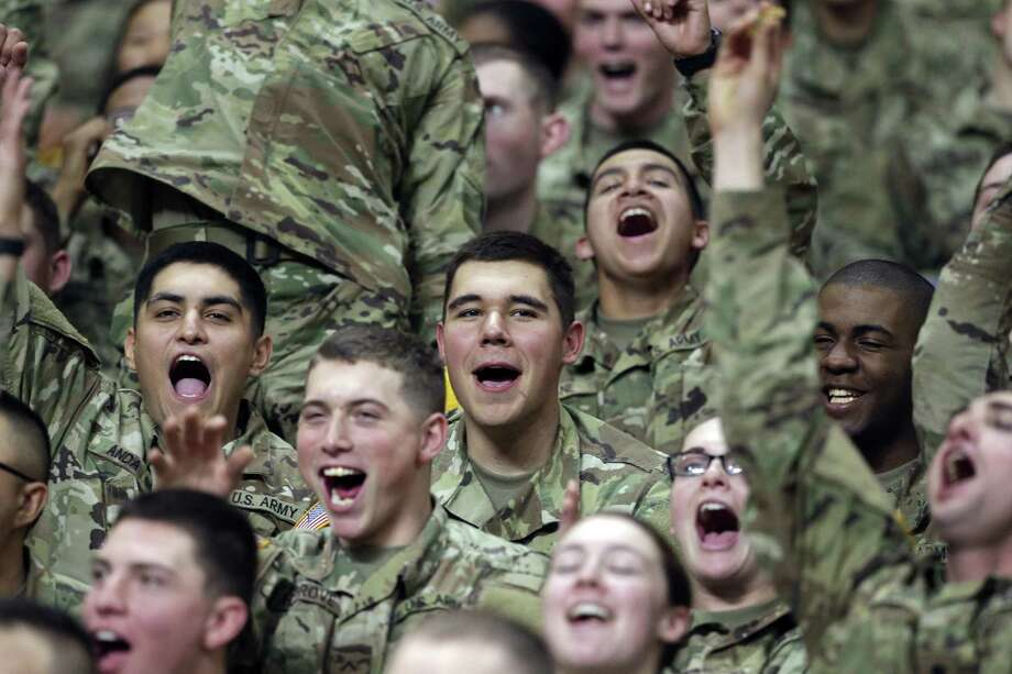 Trrops in the stands cheer at the U.S. Army All-American Bowl at the Alamodome on January 6, 2018 Photo: Tom Reel, Staff / San Antonio Express-News / 2017 SAN ANTONIO EXPRESS-NEWS