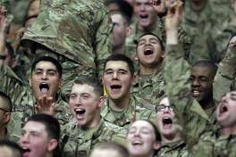 Trrops in the stands cheer at the U.S. Army All-American Bowl at the Alamodome on January 6, 2018