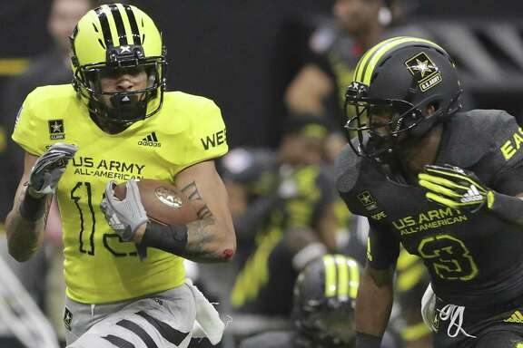 Former Steele standout Caden Sterns (left) returns an interception at the U.S. Army All-American Bowl in January.