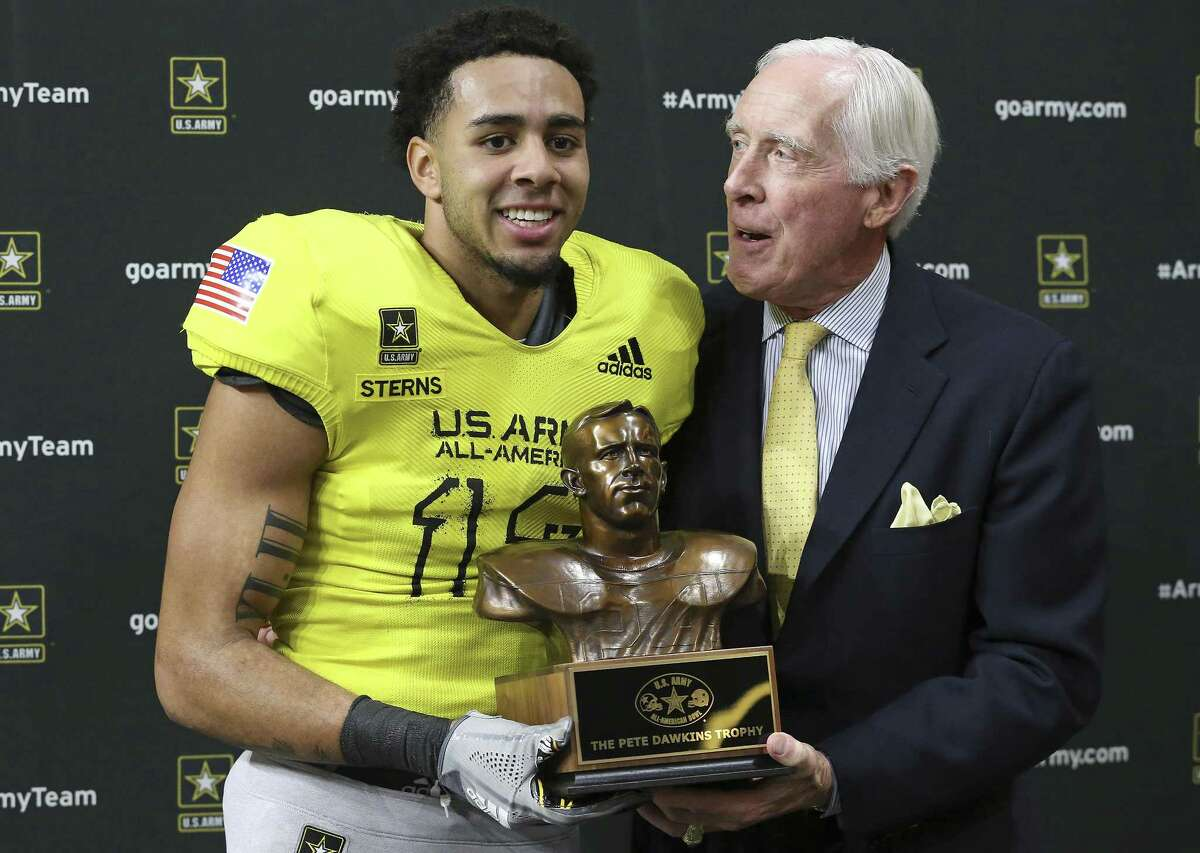 Texas freshman safety Caden Sterns, accepting the Pete Dawkins Trophy from its namesake at the Alamodome in January, is pushing for a starting position.
