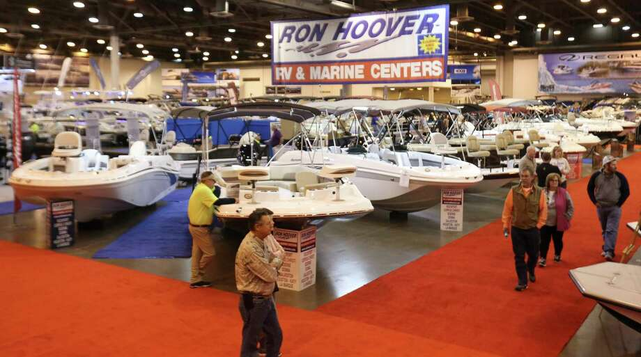 Dealers and participants walk around to see different boats at the 63rd annual Houston International Boat, Sport and Travel Show, also known as Houston Boat Show, at NRG Center on Friday, Jan. 5, 2018, in Houston. ( Yi-Chin Lee / Houston Chronicle ) Photo: Yi-Chin Lee, Houston Chronicle / © 2018  Houston Chronicle