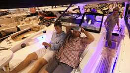 Harold Gore, right, and his son, Brandon, try out the front lounge of the 2018 Sea Ray 320DA-0B at the 63rd annual Houston International Boat, Sport and Travel Show, also known as Houston Boat Show, at NRG Center on Friday, Jan. 5, 2018, in Houston. ( Yi-Chin Lee / Houston Chronicle )