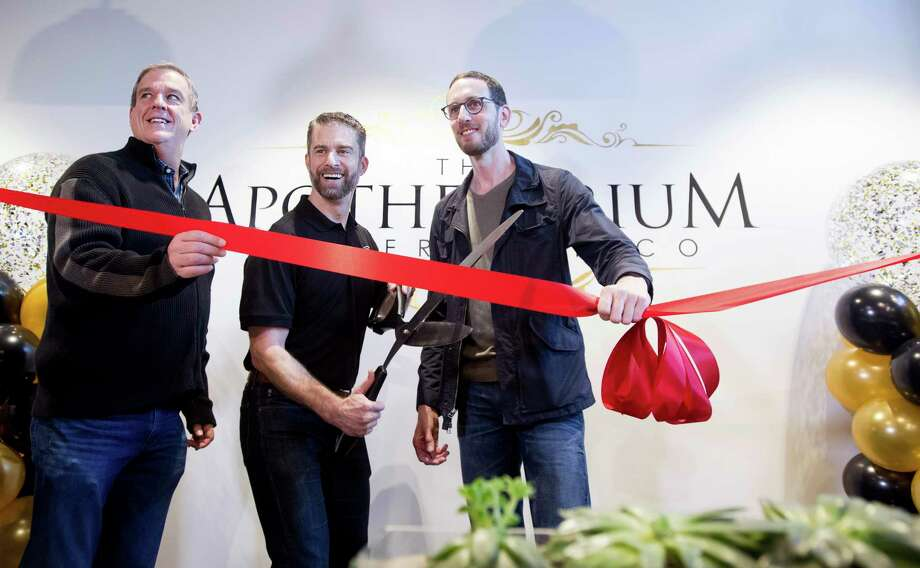 California State Sen. Scott Weiner, right, celebrates the opening of The Apothecarium for recreational marijuana sales in San Francisco on Saturday, Jan. 6, 2018. Joining him are The Apothecarium co-founder and CEO Ryan Hudson, center, and San Francisco Supervisor Jeff Sheehy. (AP Photo/Noah Berger) Photo: Noah Berger / FR34727 AP