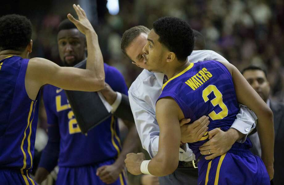 LSU coach Will Wade hugs guard Tremont Waters (3) after Waters made the game-winning three with 0.7 seconds left. Photo: Sam Craft / Associated Press / AP