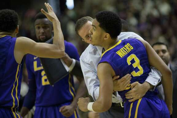 LSU coach Will Wade hugs guard Tremont Waters (3) after Waters made the game-winning three with 0.7 seconds left.