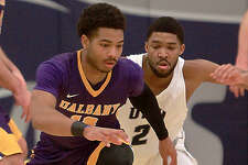 UAlbany's David Nichols goes for a loose ball Saturday, January 6, 2018, in a men's basketball game against University of New Hampshire at UNH's Lundholm Gym. (Nicole Goodhue Boyd / New Hampshire Union Leader)