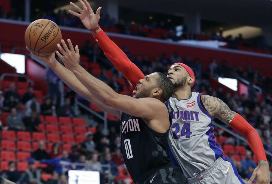 Houston Rockets guard Eric Gordon (10) attempts a layup defended by Detroit Pistons forward Eric Moreland during the second half of an NBA basketball game, Saturday, Jan. 6, 2018, in Detroit. (AP Photo/Carlos Osorio) Photo: Carlos Osorio/Associated Press