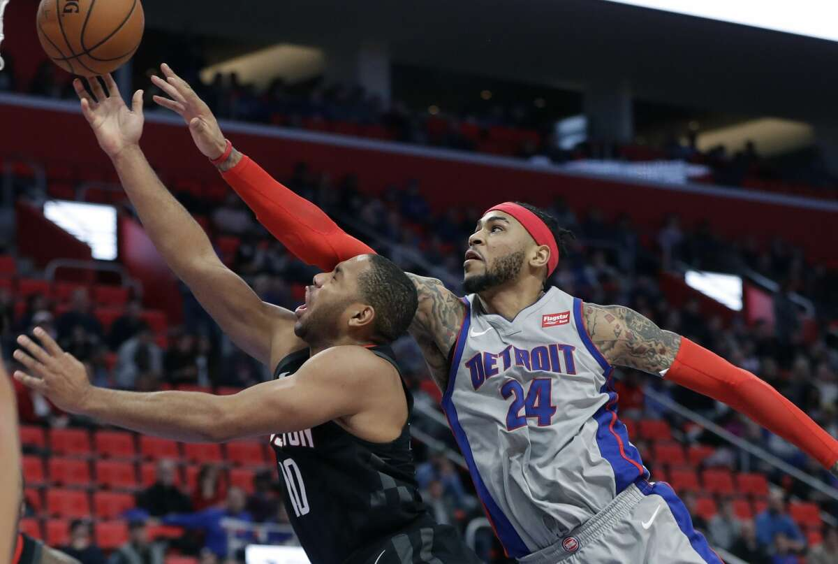 Houston Rockets guard Eric Gordon (10) attempts a layup defended by Detroit Pistons forward Eric Moreland during the second half of an NBA basketball game, Saturday, Jan. 6, 2018, in Detroit. (AP Photo/Carlos Osorio)