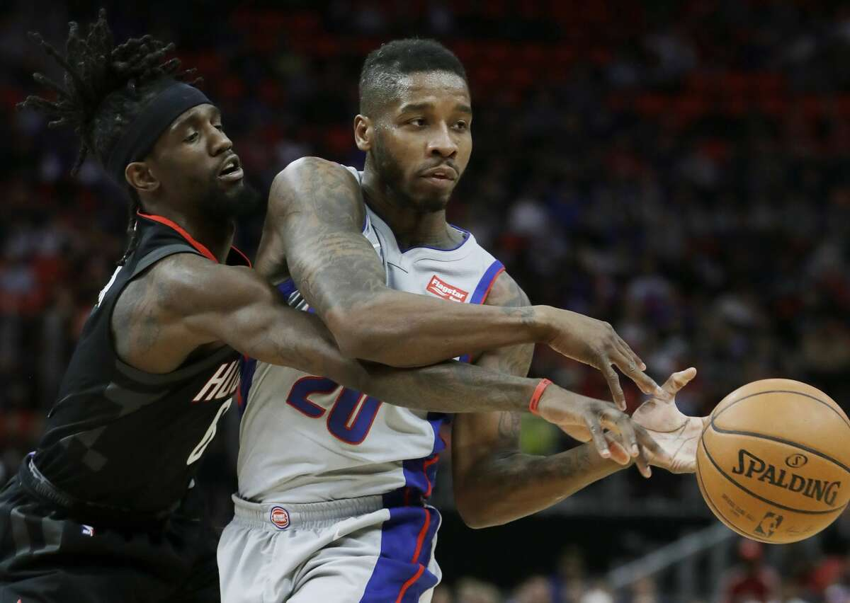 Houston Rockets guard Briante Weber (0) knocks the ball away from Detroit Pistons guard Dwight Buycks (20) during the first half of an NBA basketball game, Saturday, Jan. 6, 2018, in Detroit. (AP Photo/Carlos Osorio)