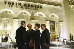 Symphony board chairwoman Kathleen Weir Vale and her husband, Albert Vale, stand in front of the Tobin Center, chatting with Mayor Ron Nirenberg and County Judge Nelson Wolff before a performance of the San Antonio Symphony on Saturday