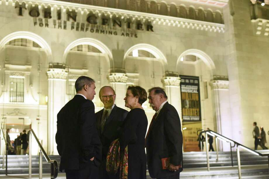 San Antonio Mayor Ron Nirenberg, left, County Judge Nelson Wolff, symphony board chairwoman Kathleen Weir Vale and her husband, Albert Vale, chatted outside the Tobin Center for the Performing Arts before the San Antonio Symphony's Jan. 6 concert. The city and county are helping fund the orchestra's current season. Photo: Billy Calzada /San Antonio Express-News / San Antonio Express-News