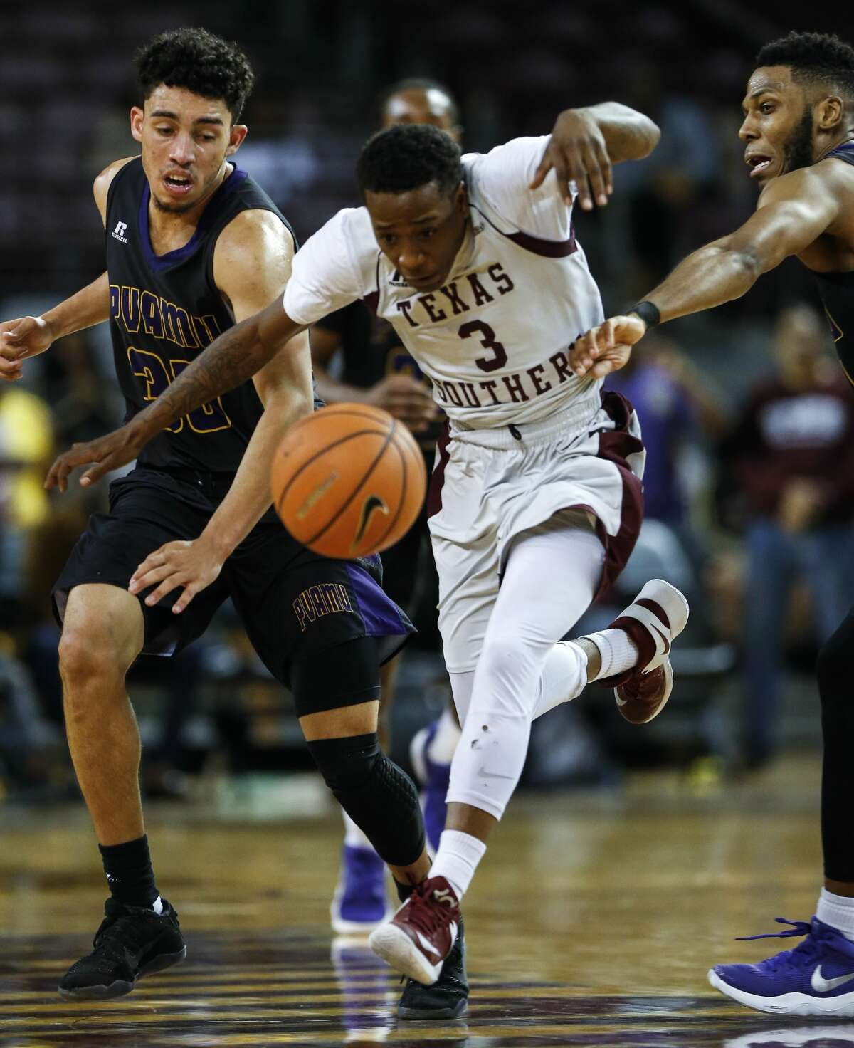 Texas Southern guard Demontrae Jefferson (3) runs between Prairie View A&M guard Austin Starr (30) and forward Zachary Hamilton (14) as he takes the ball upcourt during the second half of an NCAA basketball game at TSU's HPE Arena on Saturday, Jan. 6, 2018, in Houston. ( Brett Coomer / Houston Chronicle )