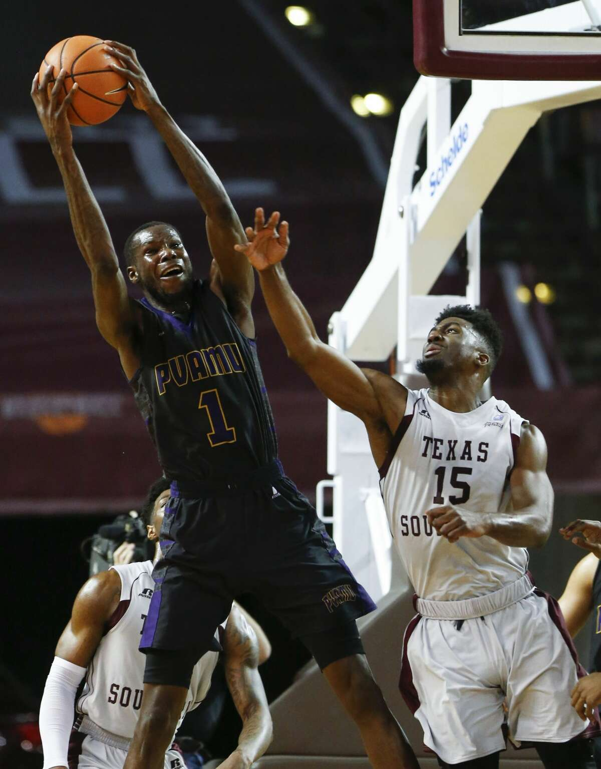 Prairie View A&M forward Keion Alexander (1) grabs a rebound away from Texas Southern forward Marquis Salmon (15) during the second half of an NCAA basketball game at TSU's HPE Arena on Saturday, Jan. 6, 2018, in Houston. ( Brett Coomer / Houston Chronicle )
