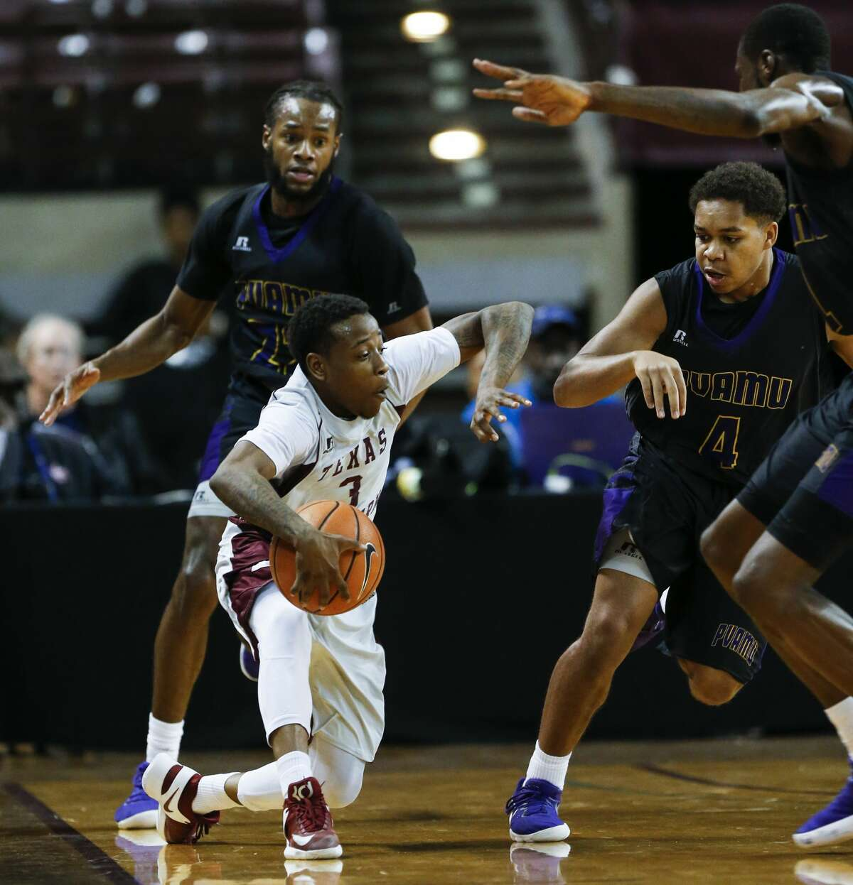 Texas Southern guard Demontrae Jefferson (3) takes the ball upcourt defended by Prairie View A&M guard Juan Hood (4) during the second half of an NCAA basketball game at TSU's HPE Arena on Saturday, Jan. 6, 2018, in Houston. ( Brett Coomer / Houston Chronicle )
