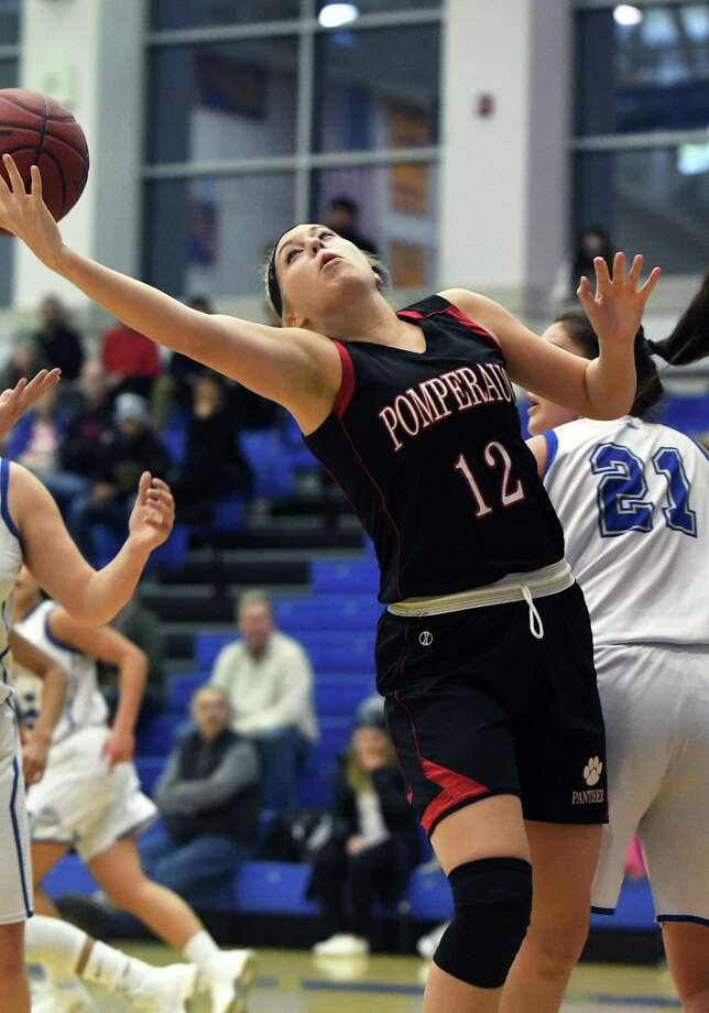 Pomperaug's Megan Todhunter tries to pull in a rebound during the Threes for Charity girls basketball tournament championship game between Newtown High and Pomperaug High at Newtown High School, Dec. 21, 2017. Photo: Krista Benson / The News-Times Freelance