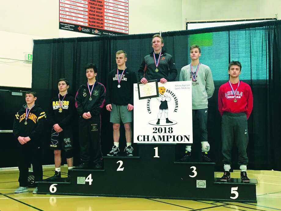 Edwardsville's Luke Odom stands as champion of the 126-pound bracket at the Cheesehead Invitational.