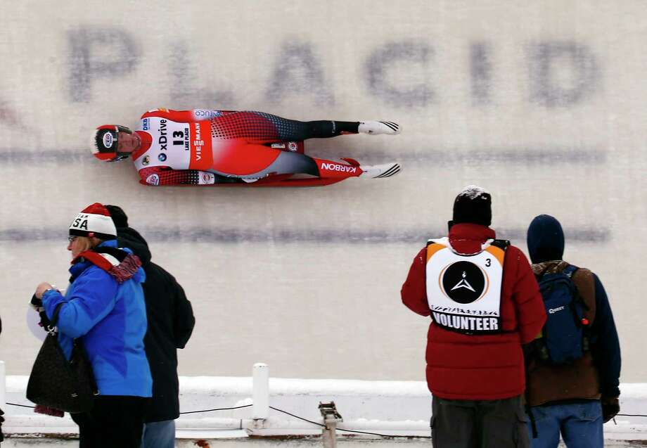 Kimberly McRae of Canada passes spectators during a Sprint World Cup luge event in Lake Placid, N.Y., on Saturday, Dec. 16, 2017. (AP Photo/Peter Morgan)  Photo: Peter Morgan, AP / Copyright 2017 The Associated Press. All rights reserved.