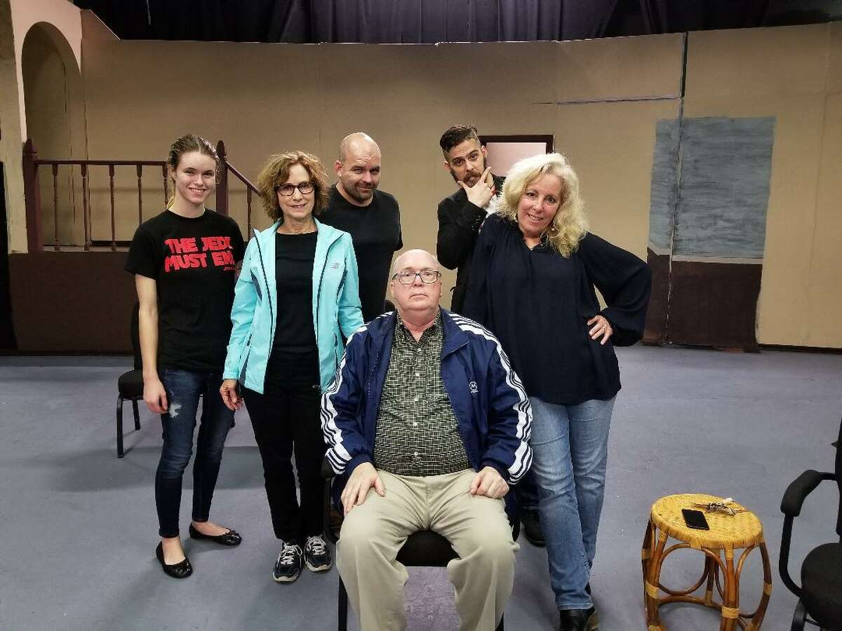 """Revis Bell, seated, directs Pasadena LIttle Theatre's production of """"Vanya and Sonia and Masha and Spike"""" Jan. 26 through Feb. 11. Bell is flanked by Barbara Winburn of Santa Fe and Jean Ciampi of League City, who play sisters in the comedy. Behind them are cast members Taylor Pruett, Stephen Walker and Edward"""