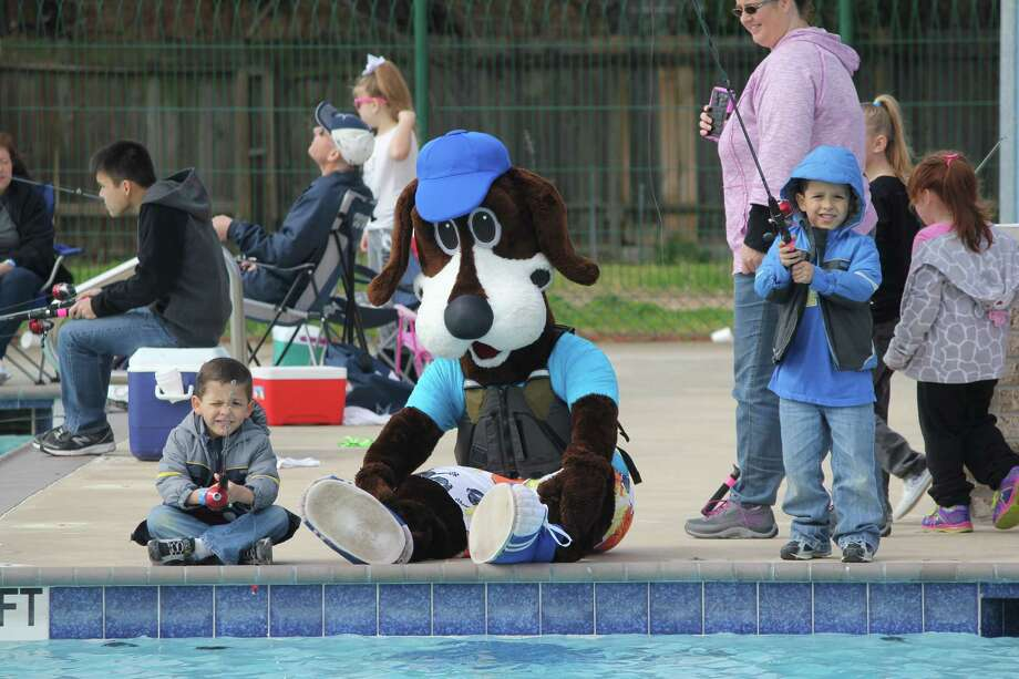 Residents of Deer Park enjoy a day fishing at a past Roscoe's Fishing Adventure at Dow Park Pool in Deer Park. This annual event  will be held this year on Jan. 26-27. Mascot Roscoe the Rec Dog, above, will cheer on those attempting to catch one of the 500 trout stocked in the swimming pool.