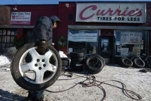 Employees at Currie's Tires for Less work on motor vehicle wheels Friday, January 5, 2018, at the shop of West Ave. in Norwalk, Conn. Severe cold weather effects vehicles adversely and in particular wheels and tires.