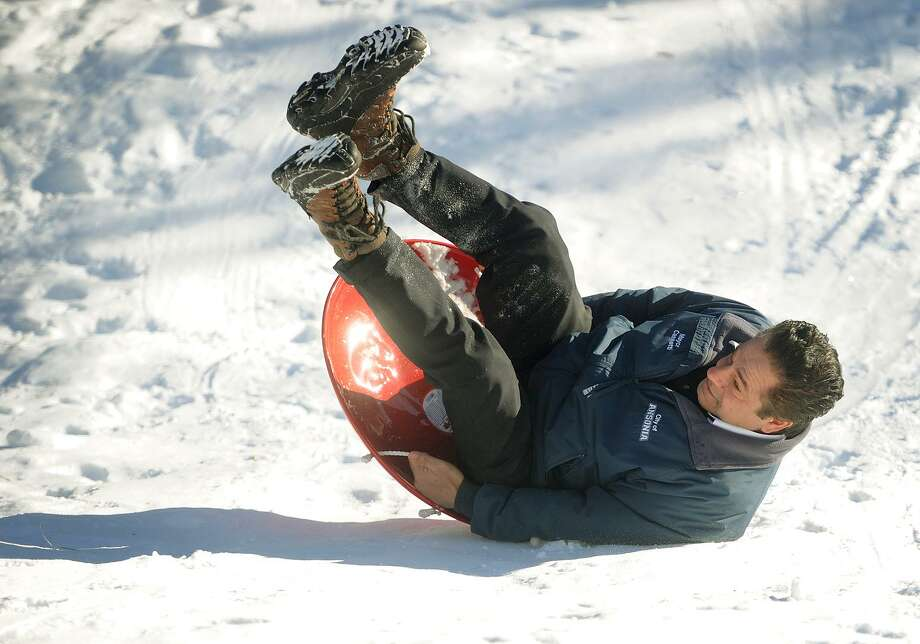 Ansonia Mayor David Cassetti takes a tumble Sunday as he takes a sled ride at the new winter playground, Photo: Brian A. Pounds / Hearst Connecticut Media / Connecticut Post