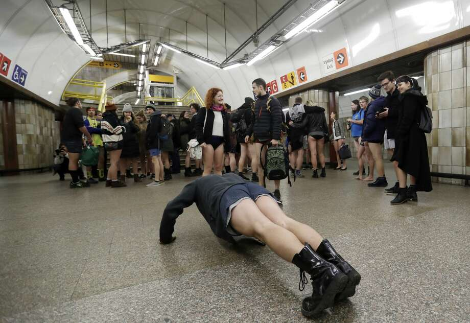 Passengers take part in the No Pants Subway Ride in Prague, Czech Republic, Sunday, Jan. 7, 2018. The No Pants Subway Ride began in 2002 in New York as a stunt and has taken place in cities around the world since then. (AP Photo/Petr David Josek) Photo: Petr David Josek/AP