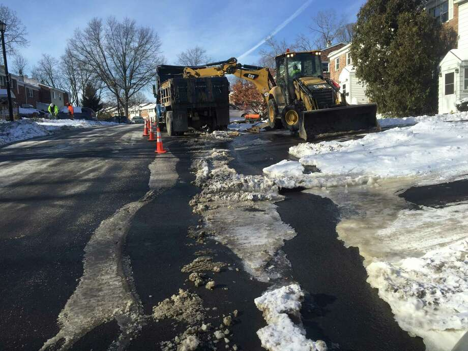 Albany public works crews work to shut down a water main break on Mount Hope Drive on Sunday afternoon Photo: Steve Hughes