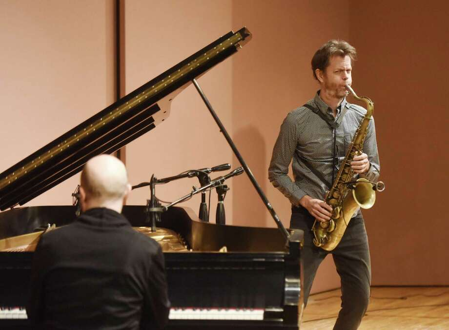 "Saxophonist Donny McCaslin and keyboard player, Jason Lindner, perform at Greenwich Library's Cole Auditorium in Greenwich, Conn. Sunday, Jan. 7, 2018. McCaslin and Lindner are known for their performance on the late rock icon David Bowie's final album, ""Blackstar, which was released shortly before Bowie's death in January of 2016. The duo performed a set of free-form jazz explorations before a packed auditorium. Photo: Tyler Sizemore / Hearst Connecticut Media / Greenwich Time"