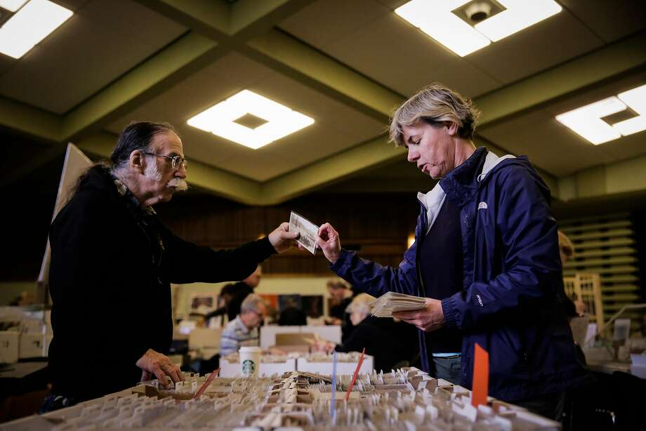 Alice Van Ommeren hands Edward Henry a vintage postcard as she searches for old picture postcards of Petaluma at the Vintage Paper Fair in Golden Gate Park. Photo: Gabrielle Lurie, The Chronicle
