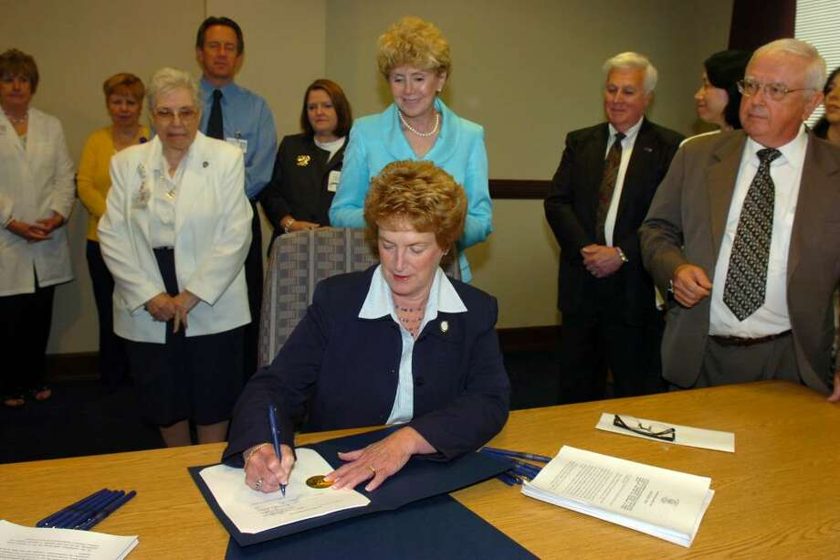 Governor M. Jodi Rell signs Senate Bill 248 at St. Vincent's Medical Center, in Bridgeport, Conn. Wednesday, June 30th, 2010. The bill expands disclosure of medical errors at hospitals and surgical clinics, and gives patients access to information regarding their complaints. Photo: Ned Gerard / Connecticut Post
