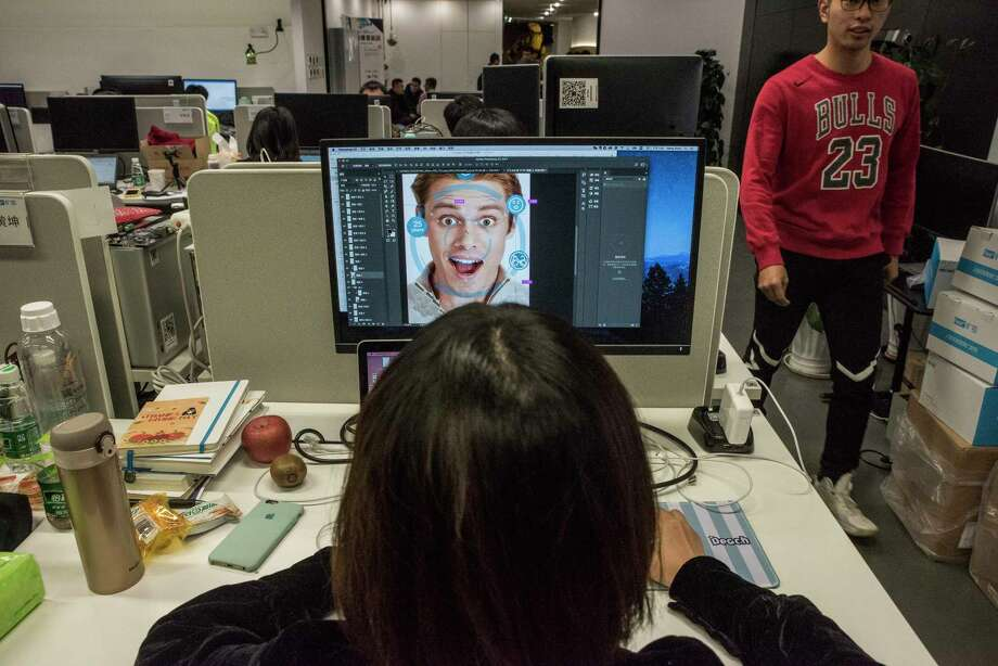 At Megvii offices in Beijing, a designer prepares marketing material for a facial-recognition product. The company's marketing manager has said Megvii's Face program has helped police make thousands of arrests. Photo: Photo For The Washington Post By Gilles Sabrié / For The Washington Post