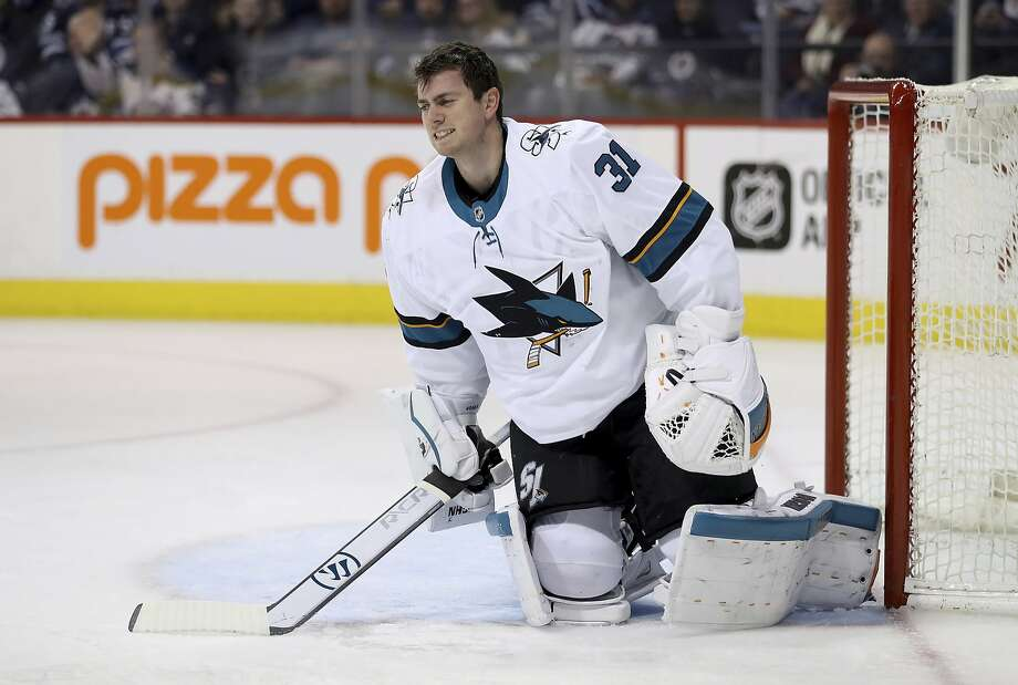 Sharks goaltender Martin Jones takes a few seconds after being hit during the second period. Photo: Trevor Hagan, Associated Press