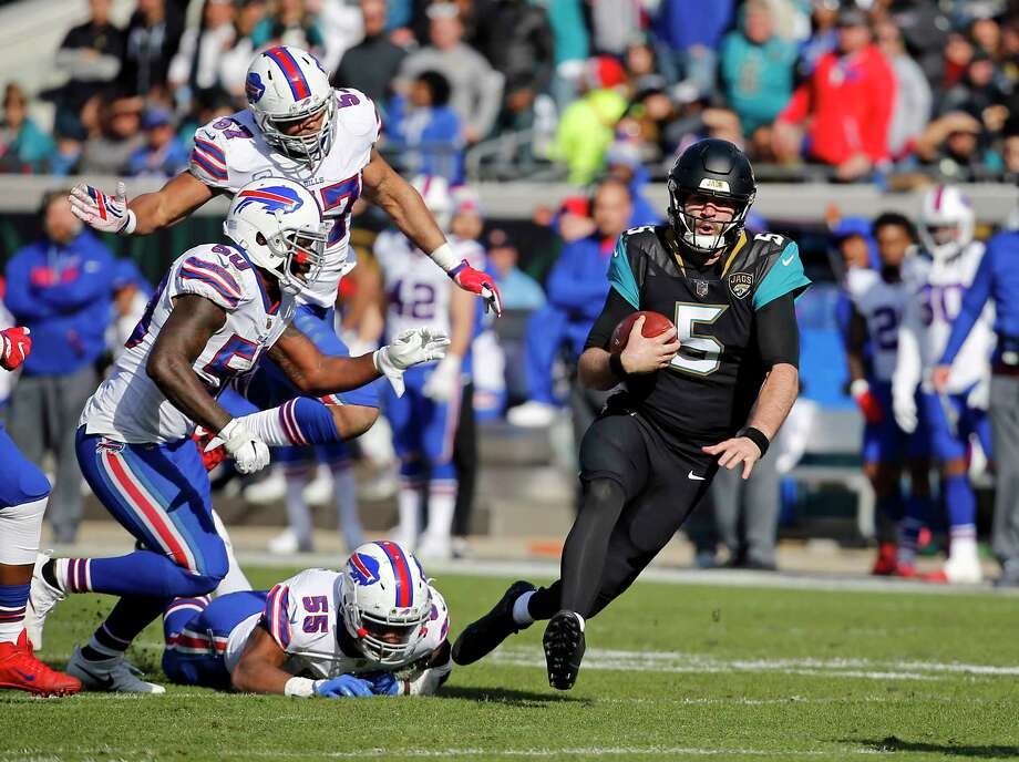 Jacksonville quarterback Blake Bortles (5) proved to be pretty elusive for the Buffalo defense in Sunday's AFC wild-card game, rushing for more yards (88) than he had passing (87). Photo: Stephen B. Morton, FRE / FR56856 AP