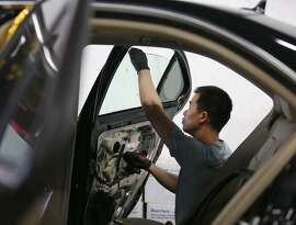 At TLC Auto Glass in San Francisco, Jimmy Lee replaces a car's window in August after a break-in.