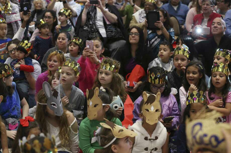 Children wait for the arrival of the Three Kings during the Puerto Rican Heritage Society's Three Kings Day celebration at San Fernando Hall, Sunday, Jan. 7, 2018. Although on officially on the sixth of January, the feast of the Epiphany celebrates the visit of the Baby Jesus by the Three Kings. Photo: JERRY LARA / San Antonio Express-News / © 2018 San Antonio Express-News