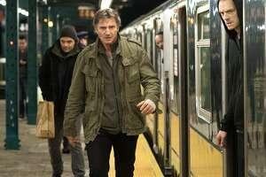 "Liam Neeson, center, in ""The Commuter."""